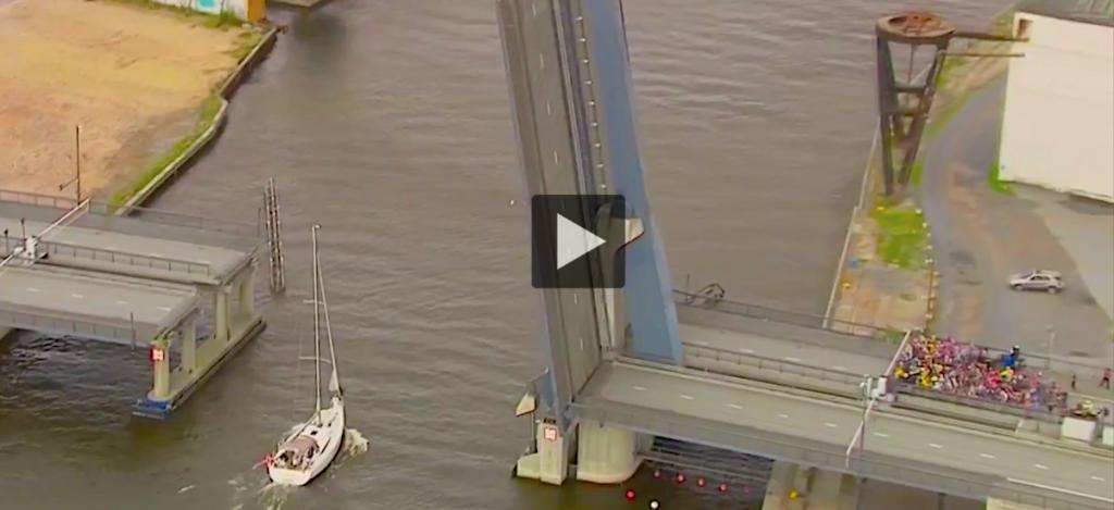 sailboat stops bike race