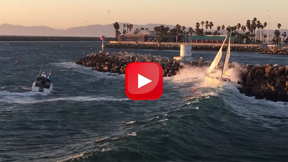 Out-of-control sailboat against the rocks